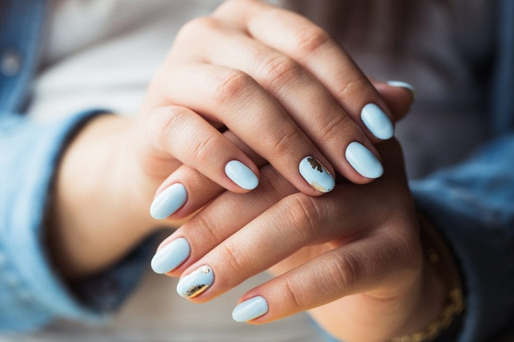 beautiful manicure. Gel polish coating in blue, embossing.
