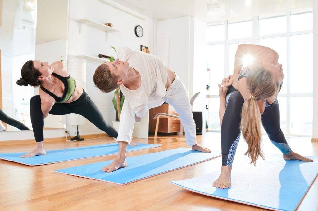 Flexible people practicing yoga