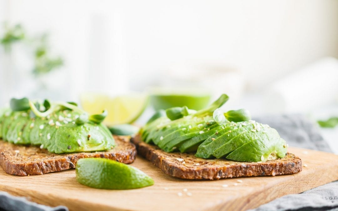 Two toasts with avocado