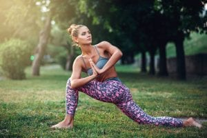 Flexible woman meditating, yoga training